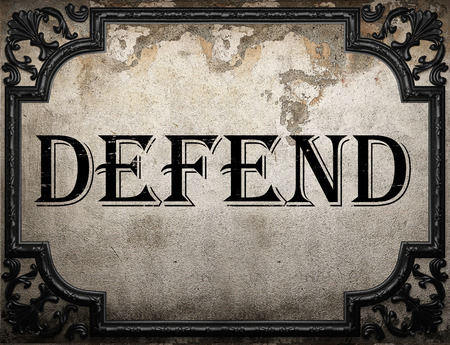 defend: defend word on concrette wall Stock Photo