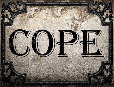 cope: cope word on concrette wall