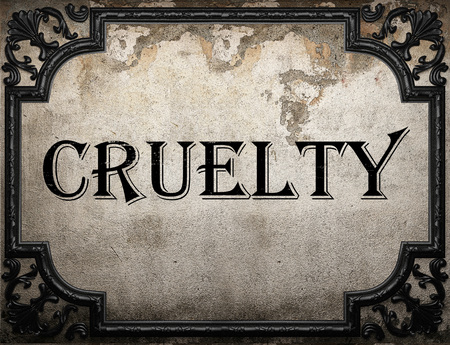 cruelty: cruelty word on concrette wall
