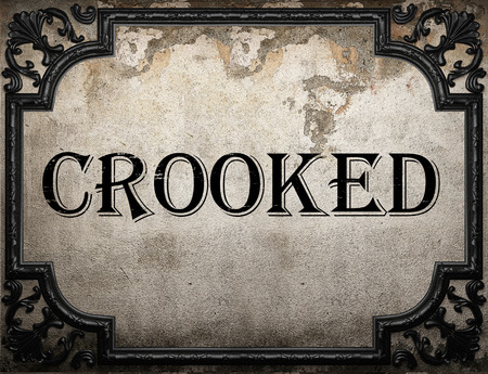 crooked: crooked word on concrette wall Stock Photo