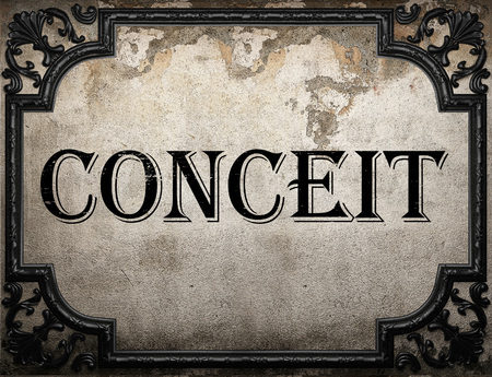 conceit: conceit word on concrette wall