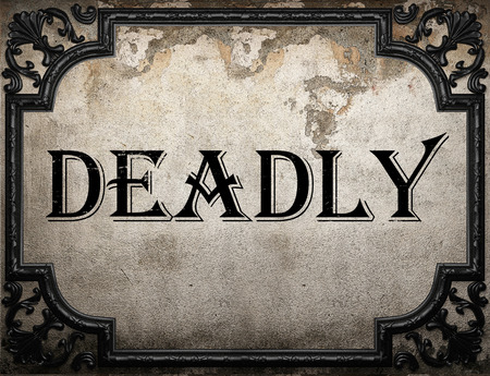 deadly: deadly word on concrette wall