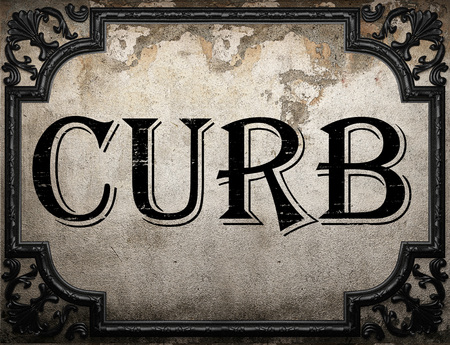curb: curb word on concrette wall Stock Photo