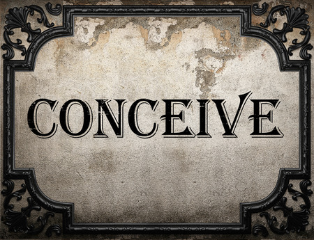 conceive: conceive word on concrette wall