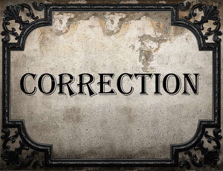 correction: correction word on concrette wall