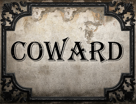 coward: coward word on concrette wall