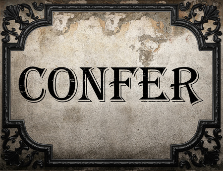 confer: confer word on concrette wall Stock Photo