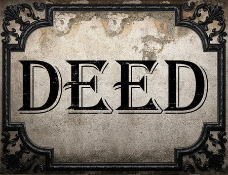 deed: deed word on concrette wall