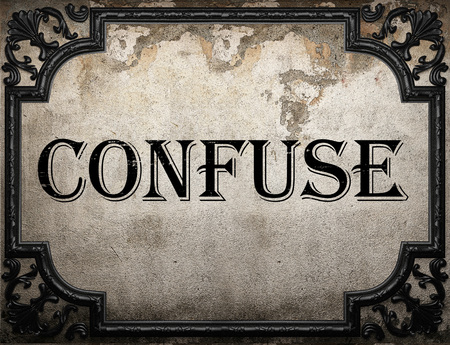 confuse word on concrette wall Stock Photo