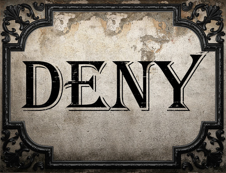 deny: deny word on concrette wall Stock Photo