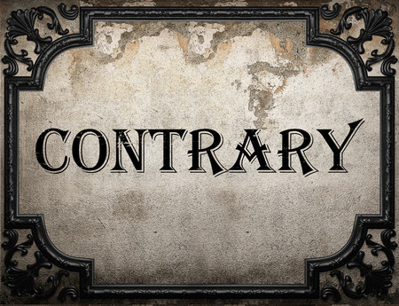 contrary: contrary word on concrette wall Stock Photo
