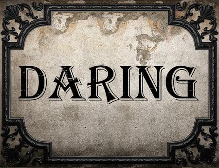 daring: daring word on concrette wall