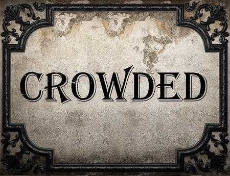 crowded: crowded word on concrette wall