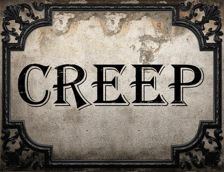 creep: creep word on concrette wall
