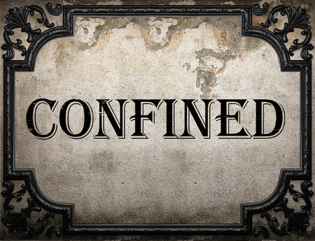 confined: confined word on concrette wall Stock Photo