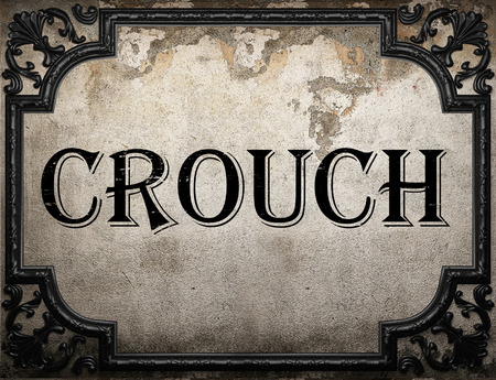 crouch: crouch word on concrette wall