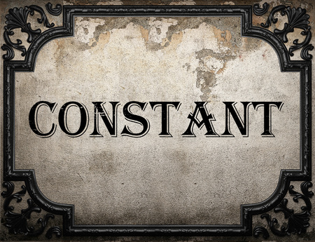 constant: constant word on concrette wall