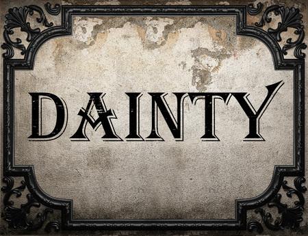 dainty: dainty word on concrette wall
