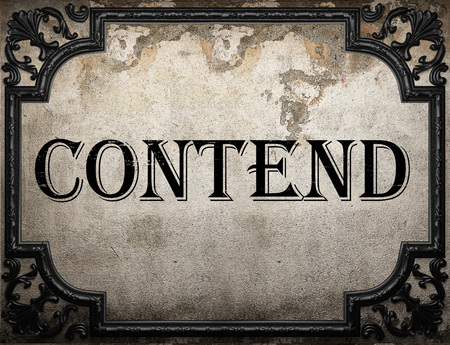 contend: contend word on concrette wall Stock Photo