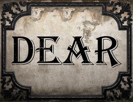 dear: dear word on concrette wall