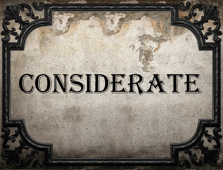 considerate: considerate word on concrette wall