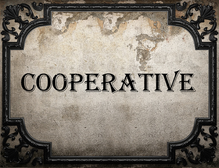cooperative word on concrette wall Stock Photo