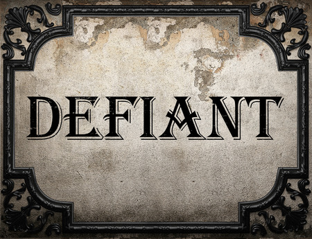 defiant: defiant word on concrette wall