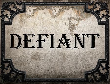 defiant: defiant word on concrette wall