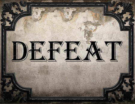 defeat: defeat word on concrette wall Stock Photo