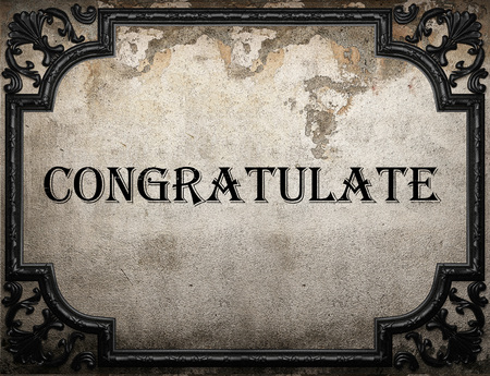 congratulate: congratulate word on concrette wall Stock Photo