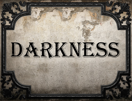 darkness: darkness word on concrette wall