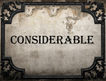 considerable: considerable word on concrette wall Stock Photo