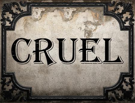 cruel: cruel word on concrette wall