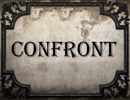 confront: confront word on concrette wall Stock Photo