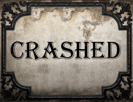 crashed: crashed word on concrette wall