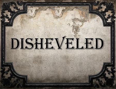 disheveled: disheveled word on concrette wall