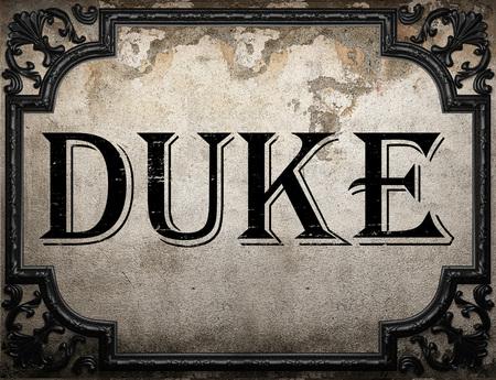 duke: duke word on concrette wall Stock Photo