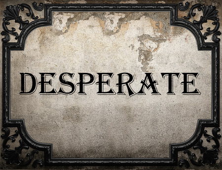 desperate: desperate word on concrette wall