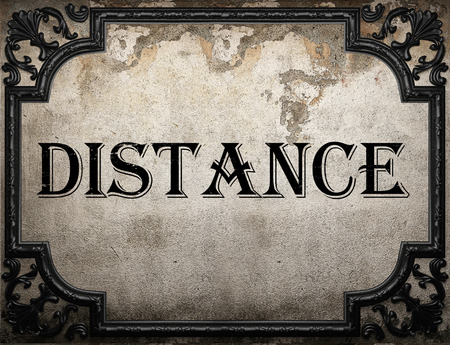 the distance: distance word on concrette wall