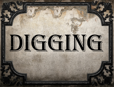 digging: digging word on concrette wall Stock Photo