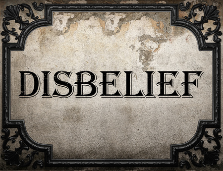 disbelief: disbelief word on concrette wall