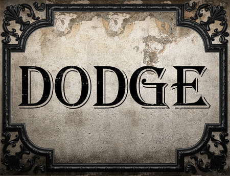 dodge: dodge word on concrette wall Stock Photo