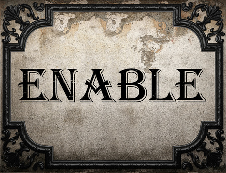 enable: enable word on concrette wall Stock Photo