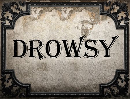 drowsy: drowsy word on concrette wall Stock Photo