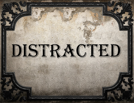 distracted: distracted word on concrette wall