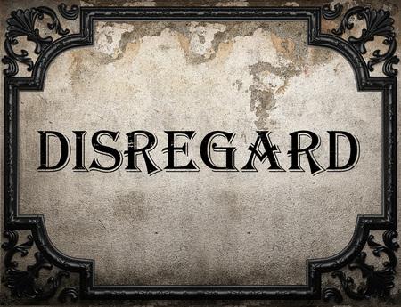 disregard: disregard word on concrette wall