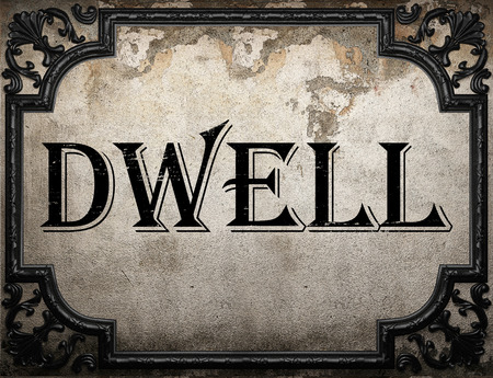 dwell: dwell word on concrette wall