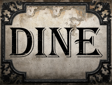 dine: dine word on concrette wall