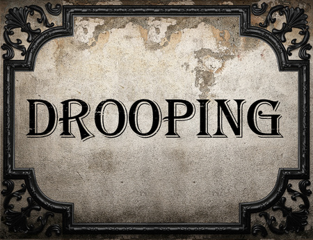 drooping: drooping word on concrette wall Stock Photo