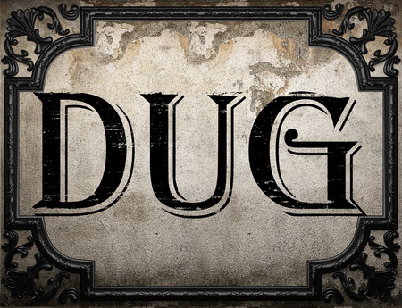 dug: dug word on concrette wall